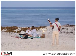 Romantic Cancun Picnic on the beach with musician